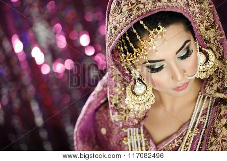 Portrait of a Beautiful Elegant Female Model in Traditional Ethnic Indian Asian Bridal  Costume with Makeup and Heavy Jewellery