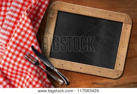 Empty Blackboard With Cutlery