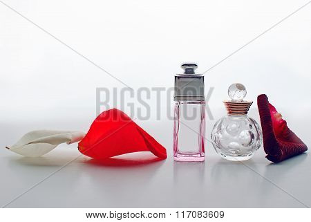 Small Bottles Of Perfume On A White Background