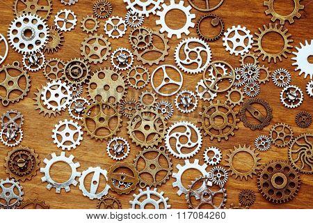 vintage gear wheels on wooden background