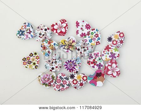 colorful heart-shaped buttons isolated on white background