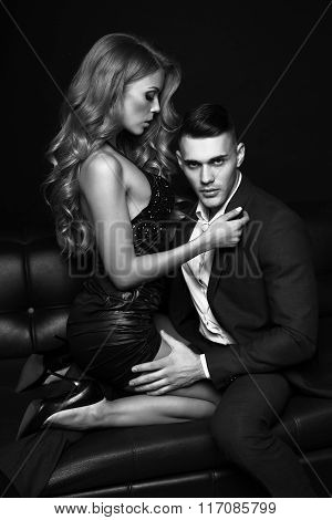fashion photo of beautiful impassioned couple