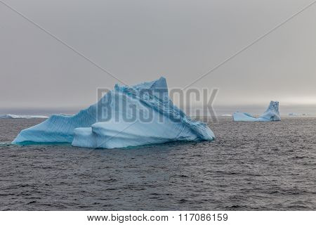 Iceberg Drifting At Lemaire Channel, Antarctica