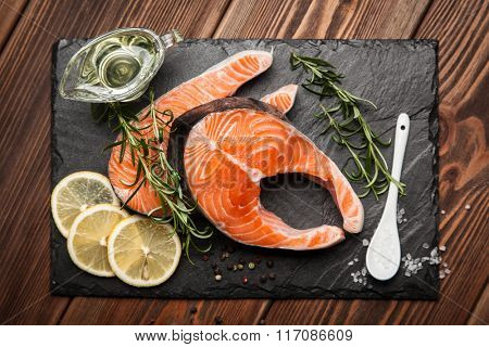 Fresh salmon on old wood