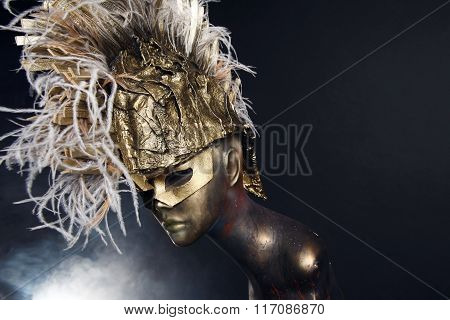 Mannequin in head wear with feathers