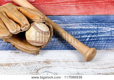 Old Worn Baseball Equipment On Faded Boards Painted In American National Colors