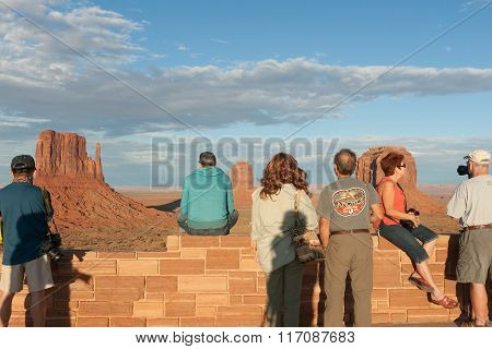Touirists Taking In The View In Monument Valley
