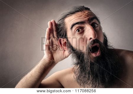 Long-bearded man listening