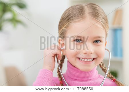 Little girl playing with stethoscope