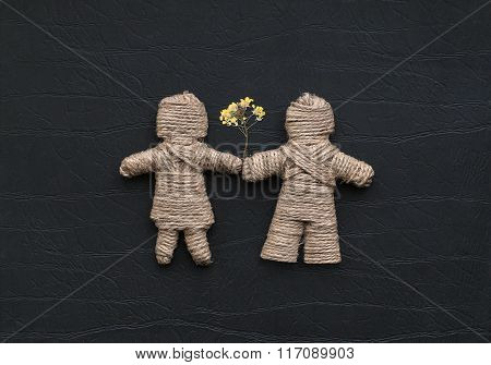 Boy And Girl Are Made Of Hemp Rope Holding Flowers. Be My Valentine Forever
