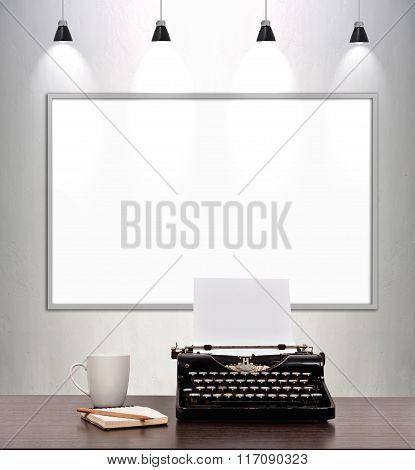 Typewriter And Blank Placard On Wall