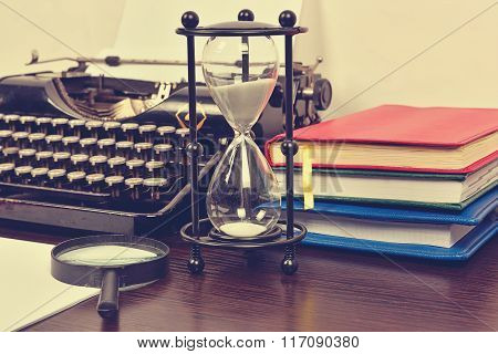 Hourglass, Books And Vintage Typewriter