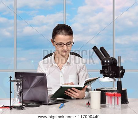 Female Scientist Reading A Book