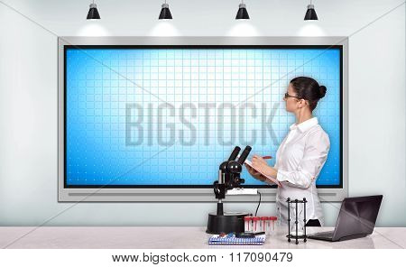 Woman Scientific Researcher Looking On Tv Screen