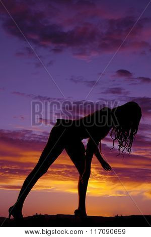 Silhouette Of A Woman In A Short Skirt Bent Over