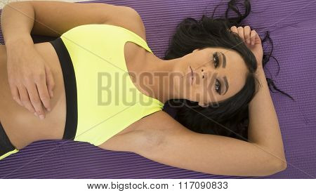 Woman In Green And Black Fitness Clothes Upper Body Lay