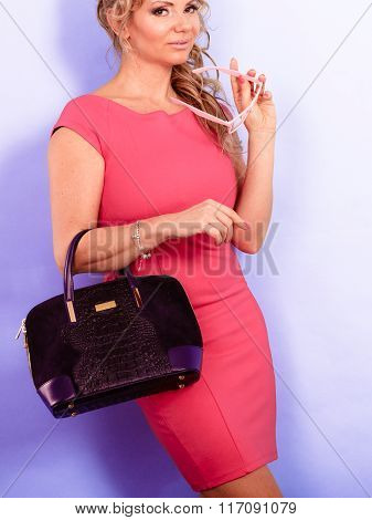 Dmature Fashion Woman Holds Handbag