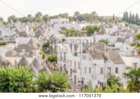 Defocused Background With Typical Trulli Buildings In Alberobello, Apulia, Italy