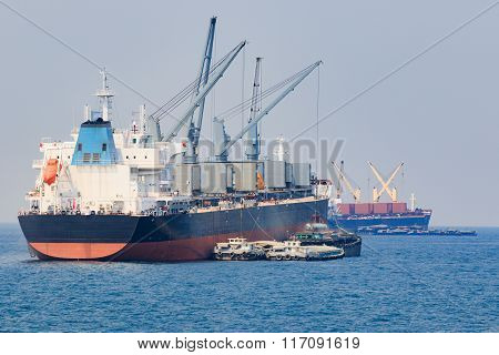 Container Boat Loading Goods Over Clear Blue Water Sea Use For Vessel ,nautical Transportation And O