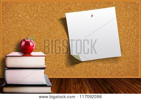 Education Concept With Apple On Books And Corkboard Background