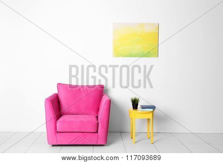 Living room interior with pink armchair and yellow chair on white wall background