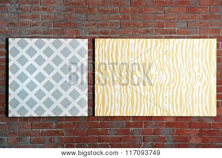 Abstract pictures on a brick wall background