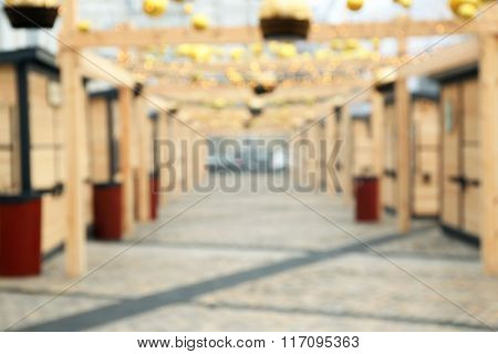 Traditional Christmas fair kiosks, blurred background