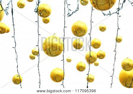 Hanging garland with Christmas balls over sky background