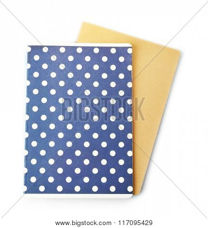 A pile of stylish notebooks, isolated on white background