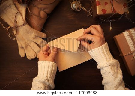 Female hands writing Christmas greeting letter