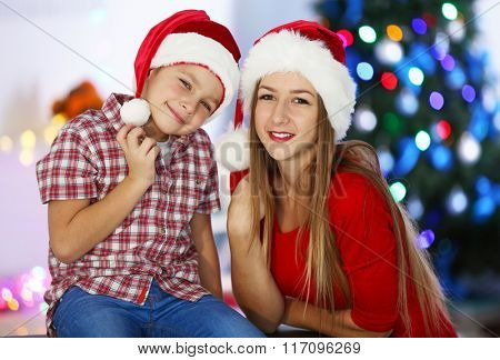 Portrait of girl and boy in decorated Christmas room