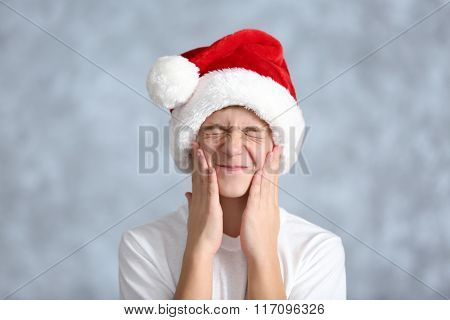 Portrait of cheerful boy on grey background