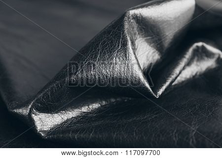 Black leather texture close up