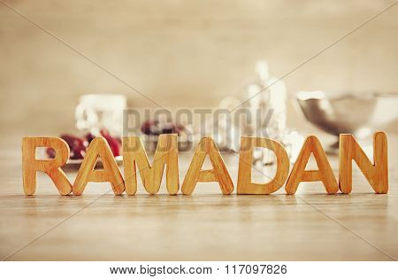 Ramadan word with wooden letters on table, close up