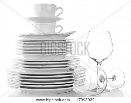 Woman wiping the dishes on white background