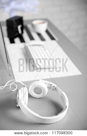 Headphones on gray table against defocused background