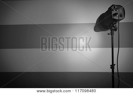 White and bright shape created on the wall with studio light flashes