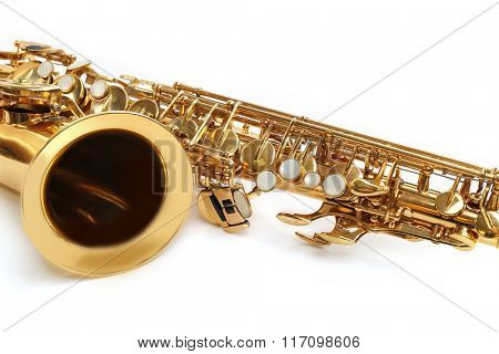 Golden saxophone isolated on white background, close up