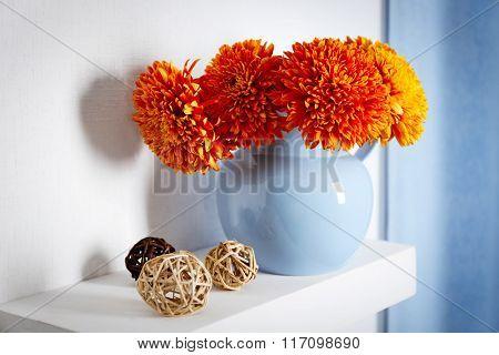 Jar with flowers on a shelf closeup