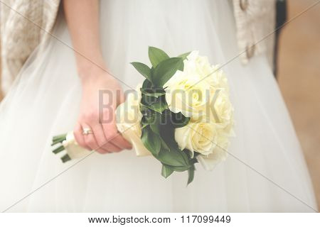 Wedding bouquet in hand of the bride