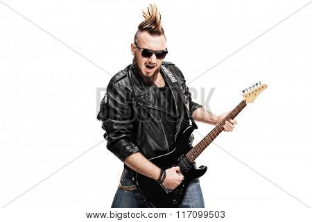 Young punk rocker playing electric guitar isolated on white background