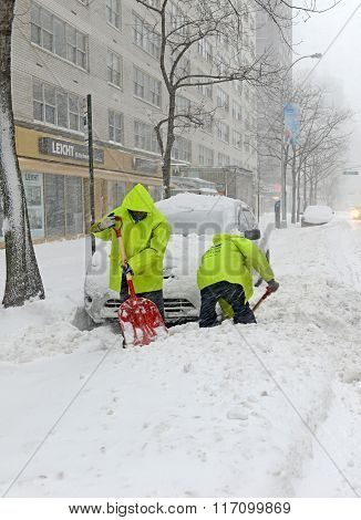 Cleanup crew working after snowstorm