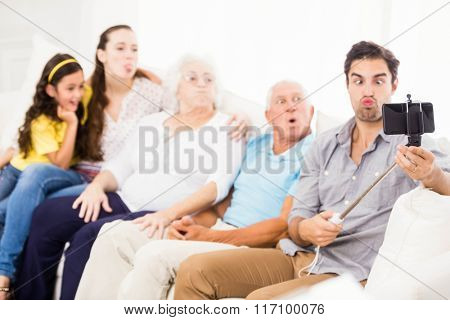 Happy extended family taking selfie at home