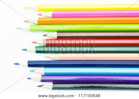 Rhythm Form Multicolored Pencils Isolated On White Background.