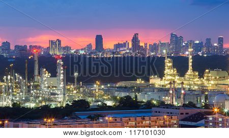 Petrochemical  refinery with city downtown background