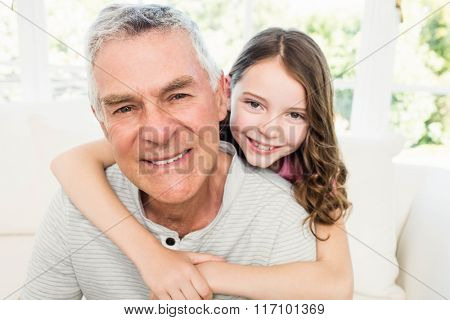 Portrait of granddad and granddaughter on the sofa