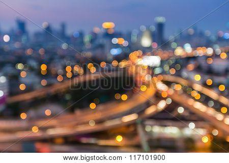 Blurred bokeh lights background, highway interchanged city downtown background