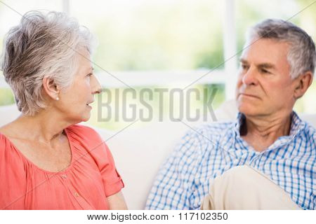 Senior couple having argument on the sofa at home