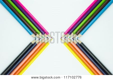 Corner from multicolored pencils isolated on white background.