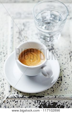 Cup of espresso and a glass of water